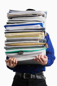 Bigstock-Carry-Pile-Of-Paperworks-7701942